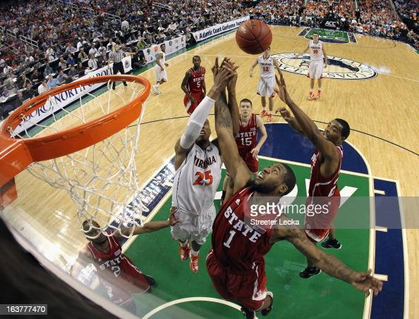 Richard Howell of the North Carolina State Wolfpack and Akil Mitchell of the Virginia Cavaliers battle for a rebound during the quarterfinals of the...