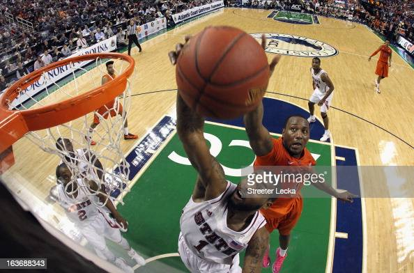 Richard Howell of the North Carolina State Wolfpack and Cadarian Raines of the Virginia Tech Hokies battle for a rebound during the first round of...