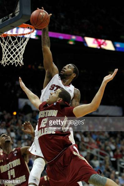 Richard Howell of the North Carolina State Wolfpack attempts a dunk against Ryan Anderson of the Boston College Eagles during their first round game...