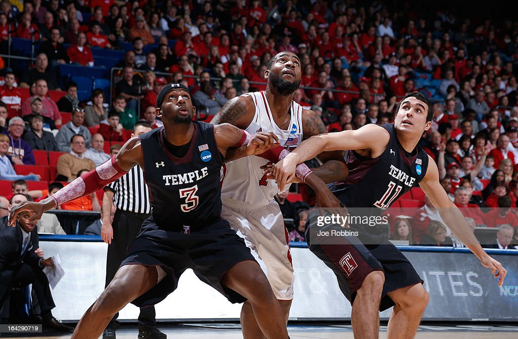Richard Howell of the North Carolina State Wolfpack battles with Anthony Lee and TJ DiLeo of the Temple Owls during a free throw in the first half...