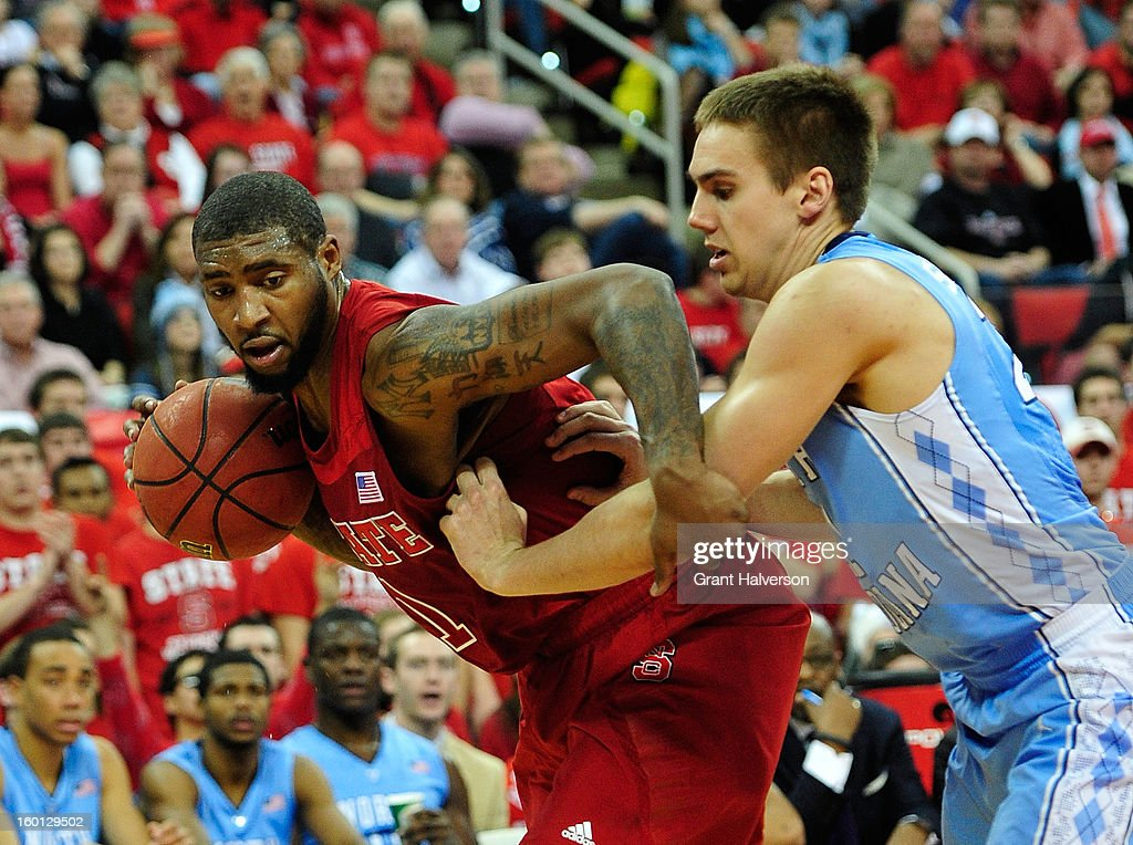 Richard Howell #1 of the North Carolina State Wolfpack drives the baseline against Jackson Simmons #21 of the North Carolina Tar Heels of during play at PNC Arena on January 26, 2013 in Raleigh, North Carolina.