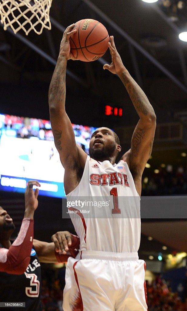 Richard Howell of the North Carolina State Wolfpack drives to the basket against Anthony Lee of the Temple Owls in the second half during the second...