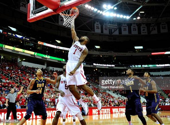 Richard Howell of the North Carolina State Wolfpack dunks a rebound against the UNC Greensboro Spartans during play at PNC Arena on December 31 2012...