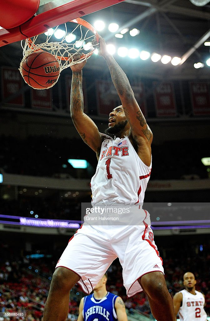 <a gi-track='captionPersonalityLinkClicked' href=/galleries/search?phrase=Richard+Howell&family=editorial&specificpeople=2313901 ng-click='$event.stopPropagation()'>Richard Howell</a> #1 of the North Carolina State Wolfpack dunks against the North Carolina-Asheville Bulldogs during play at PNC Arena on November 23, 2012 in Raleigh, North Carolina.