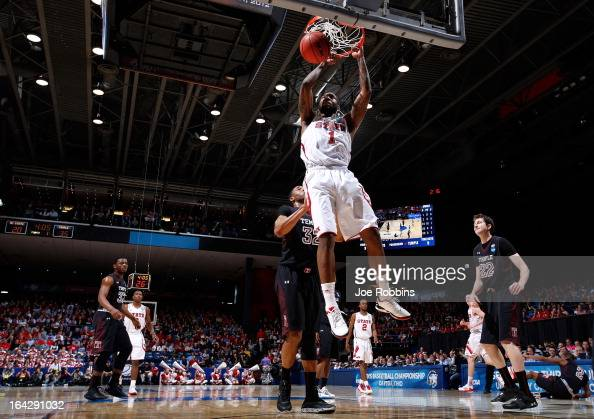 Richard Howell of the North Carolina State Wolfpack dunks the ball against the Temple Owls in the first half during the second round of the 2013 NCAA...