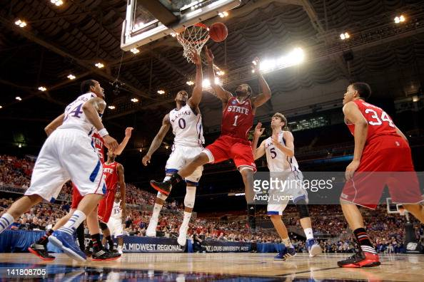 Richard Howell of the North Carolina State Wolfpack fights for control of a rebound against Thomas Robinson and Jeff Withey of the Kansas Jayhawks...