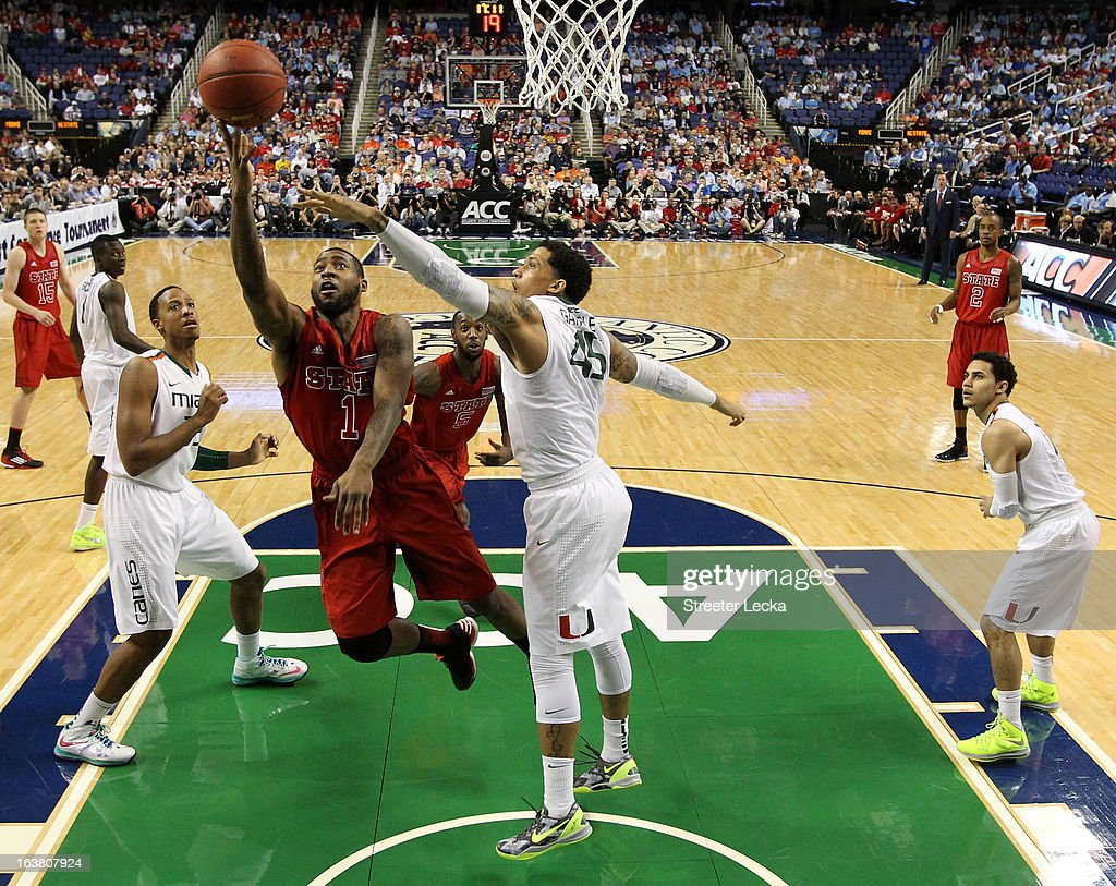 Richard Howell of the North Carolina State Wolfpack goes up for a shot against Julian Gamble of the Miami Hurricanes during the men's ACC Tournament...