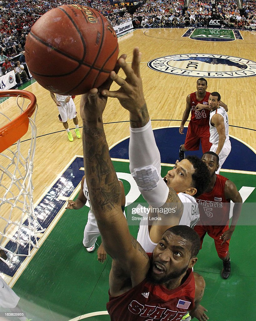 Richard Howell of the North Carolina State Wolfpack goes up for a the ball in front of Julian Gamble of the Miami Hurricanes during the men's ACC...