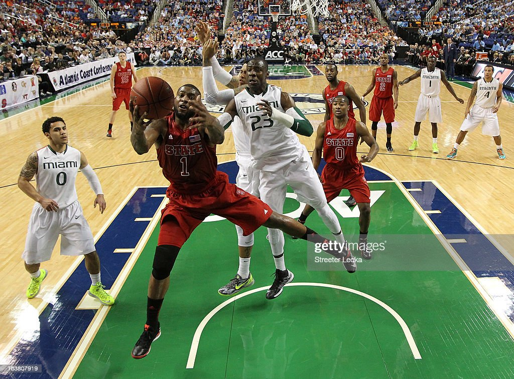 Richard Howell of the North Carolina State Wolfpack grabs a rebound in front of Tonye Jekiri of the Miami Hurricanes during the men's ACC Tournament...