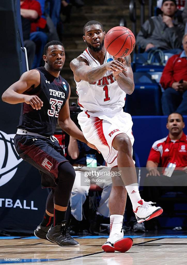 Richard Howell of the North Carolina State Wolfpack passes the ball against Scootie Randall of the Temple Owls in the second half during the second...