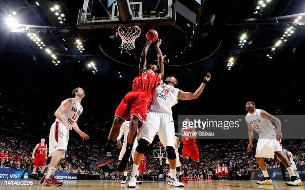Richard Howell of the North Carolina State Wolfpack shoots against Tim Shelton of the San Diego State Aztecs in the first half during the second...