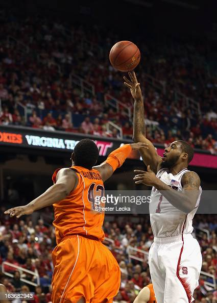Richard Howell of the North Carolina State Wolfpack shoots over CJ Barksdale of the Virginia Tech Hokies during the first round of the Men's ACC...