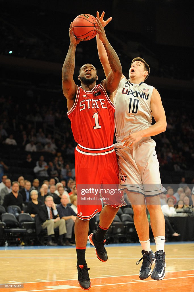 RIchard Howell #1 of the North Carolina Wolfpack takes a shot over Tyler Orlander #10 of the Connecticut Huslies during the Jimmy V Classic college basketball game on December 4, 2012 at Madison Square Garden in New York, New York. The Wolfpack won 69-65.