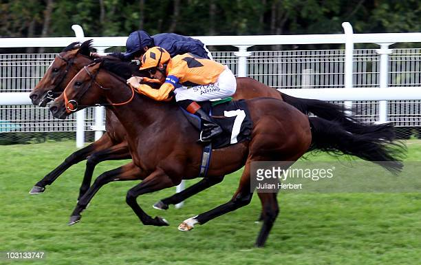 Richard Hughes and Canford Cliffs get the better of the Ryan Moore ridden Rip Van Winkle to land The Sussex Stakes run on the 2nd day of Glorious...