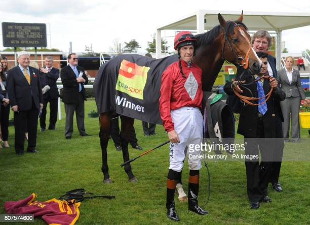 Richard Hughes and Paco Boy in the winners enclosure after victory in the totesportcom Lockinge Stakes at Newbury Racecourse