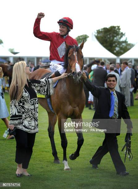 Richard Hughes celebrates after victory on Paco Boy in totesportcom Lockinge Stakes at Newbury Racecourse