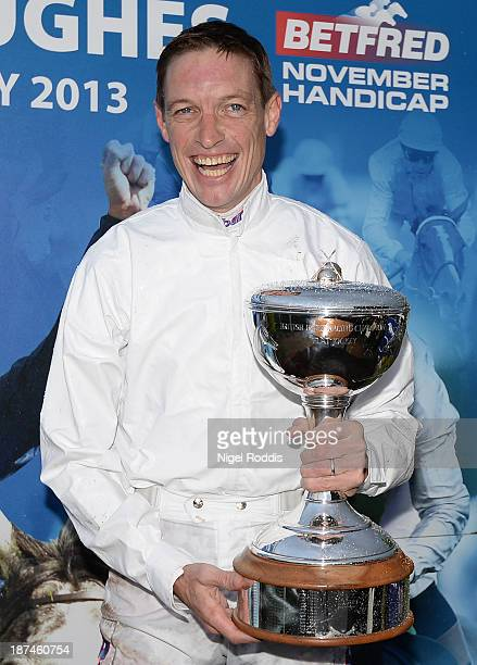 Richard Hughes celebrates winning the 2013 champion jockeys title at Doncaster racecourse on November 9 2013 in Doncaster England