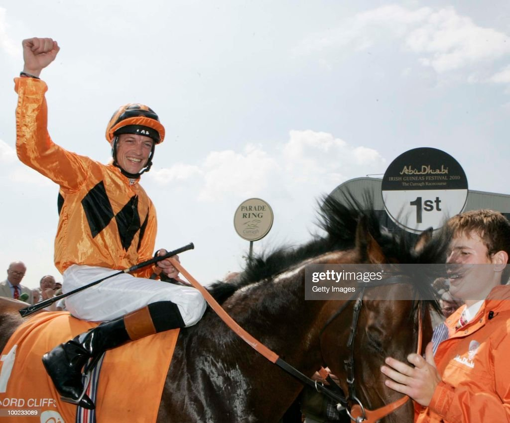Richard Hughes is led in on Canford Cliffs after winning The Abu Dhabi Irish 2000 Guineas at Curragh Racecourse on May 22 2010 in Kildare Republic of...