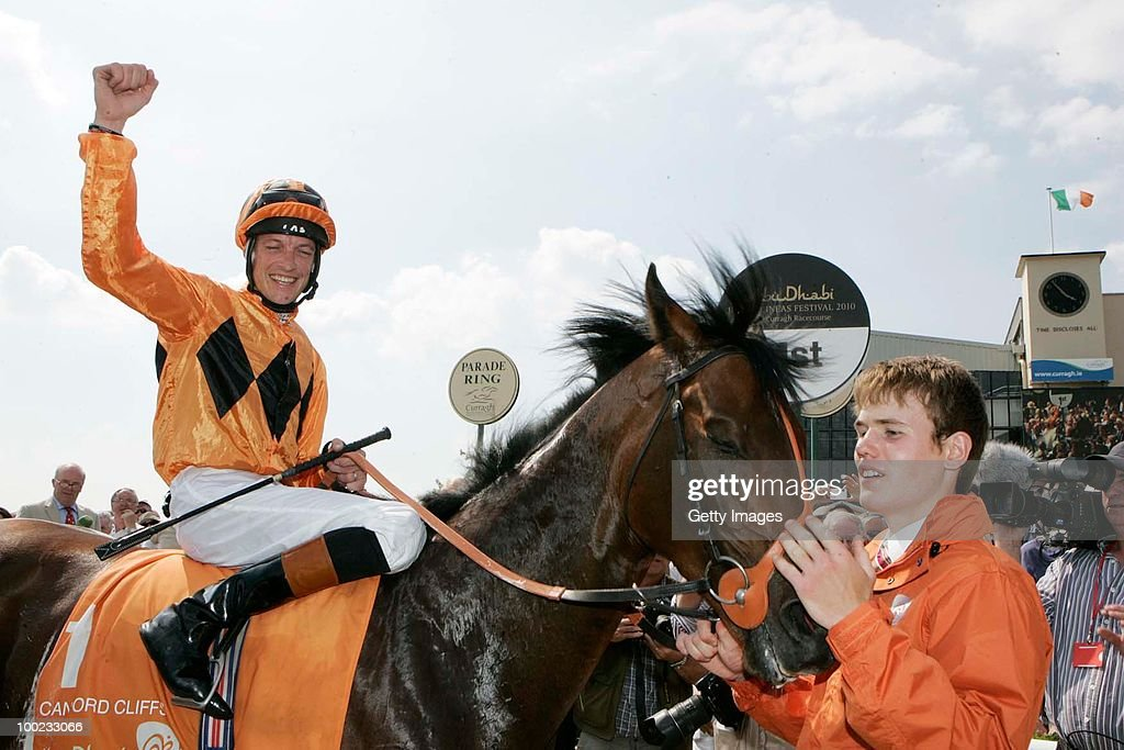 Richard Hughes is led in on Canford Cliffs by Will Ingram after winning The Abu Dhabi Irish 2000 Guineas at Curragh Racecourse on May 22 2010 in...