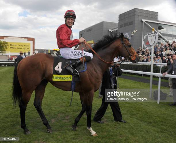 Richard Hughes on Paco Boy in the winners enclosure after victory in the totesportcom Lockinge Stakes at Newbury Racecourse