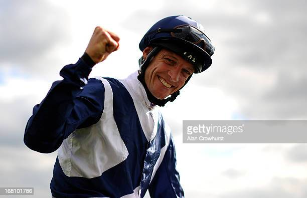 Richard Hughes on Sky Lantern celebrates after winning The Qipco 1000 Guineas Stakes at Newmarket racecourse on May 05 2013 in Newmarket England