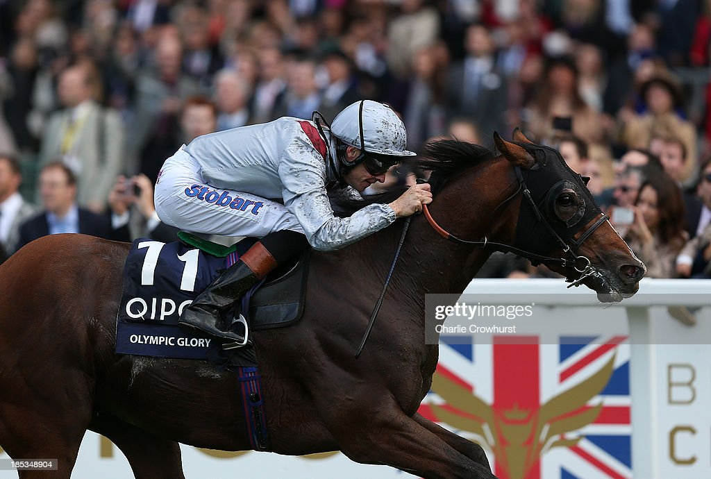 <a gi-track='captionPersonalityLinkClicked' href=/galleries/search?phrase=Richard+Hughes+-+Jockey&family=editorial&specificpeople=206680 ng-click='$event.stopPropagation()'>Richard Hughes</a> rides Olympic Glory to win The Queen Elizabeth II Stakes sponsored by QIPCO at Ascot racecourse on October 19, 2013 in Ascot, England.