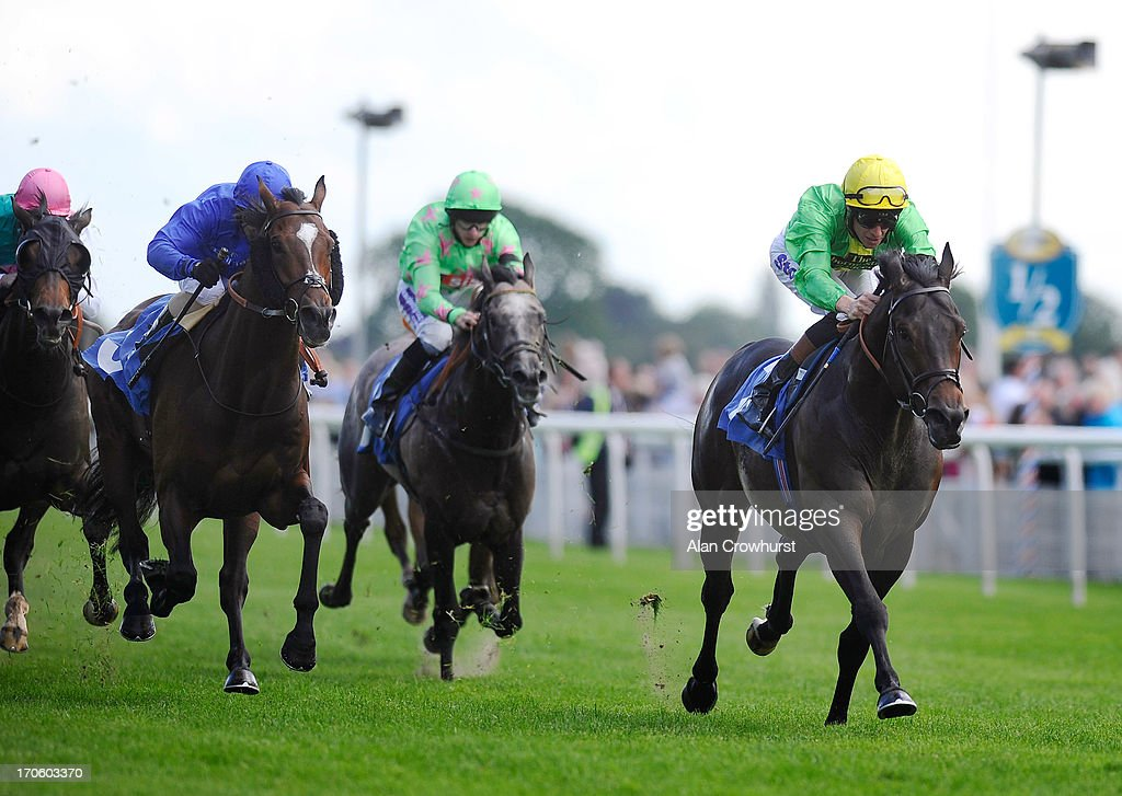 <a gi-track='captionPersonalityLinkClicked' href=/galleries/search?phrase=Richard+Hughes+-+Jockey&family=editorial&specificpeople=206680 ng-click='$event.stopPropagation()'>Richard Hughes</a> riding Baltic Knight win The Ian and Kate Hall Macmillan Ganton Stakes at York racecourse on June 15, 2013 in York, England.