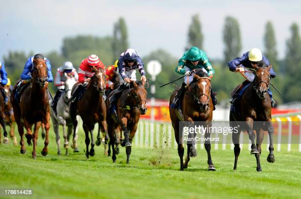 Richard Hughes riding Barley Mow win the Don Deadman Memorial EBF Fund Maiden Stakes at Newbury racecourse on August 16 2013 in Newbury England