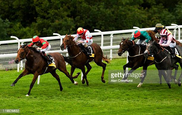Richard Hughes riding Chandlery win the Veuve Clicquot Vintage Stakes at Goodwood racecourse on July 27 2011 in Chichester England