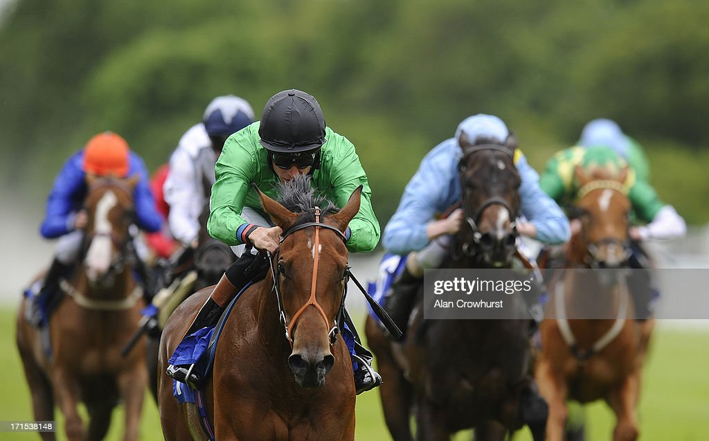 <a gi-track='captionPersonalityLinkClicked' href=/galleries/search?phrase=Richard+Hughes+-+Jockey&family=editorial&specificpeople=206680 ng-click='$event.stopPropagation()'>Richard Hughes</a> riding Chutney wins The British Stallion Studs EBF Ashbrittle Stud Maiden Fillies' Stakes at Salisbury racecourse on June 26, 2013 in Salisbury, England.
