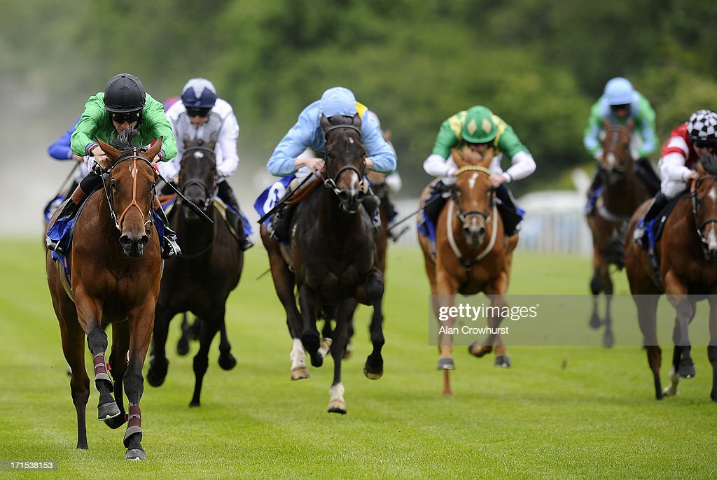 Richard Hughes riding Chutney (L) wins The British Stallion Studs EBF Ashbrittle Stud Maiden Fillies' Stakes at Salisbury racecourse on June 26, 2013 in Salisbury, England.