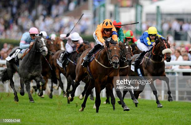Richard Hughes riding Harbour Watch win the Tanqueray Richmond Stakes at Goodwood racecourse on July 29 2011 in Chichester England