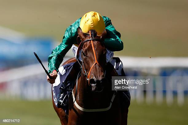 Richard Hughes riding Illuminate win The Duchess Of Cambridge Stakes at Newmarket racecourse on July 10 2015 in Newmarket England