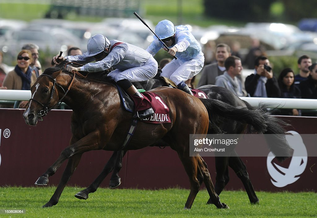 <a gi-track='captionPersonalityLinkClicked' href=/galleries/search?phrase=Richard+Hughes+-+Jockey&family=editorial&specificpeople=206680 ng-click='$event.stopPropagation()'>Richard Hughes</a> riding Olympic Glory (L) win The Prix Jean luc Lagardere at Longchamp racecourse on October 07, 2012 in Paris, France.