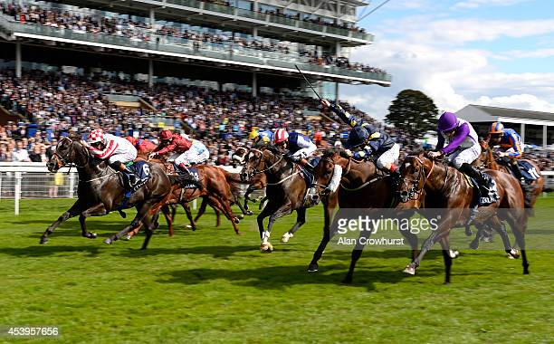Richard Hughes riding Sole Power win The Coolmore Nunthorpe Stakes at York racecourse on August 22 2014 in York England