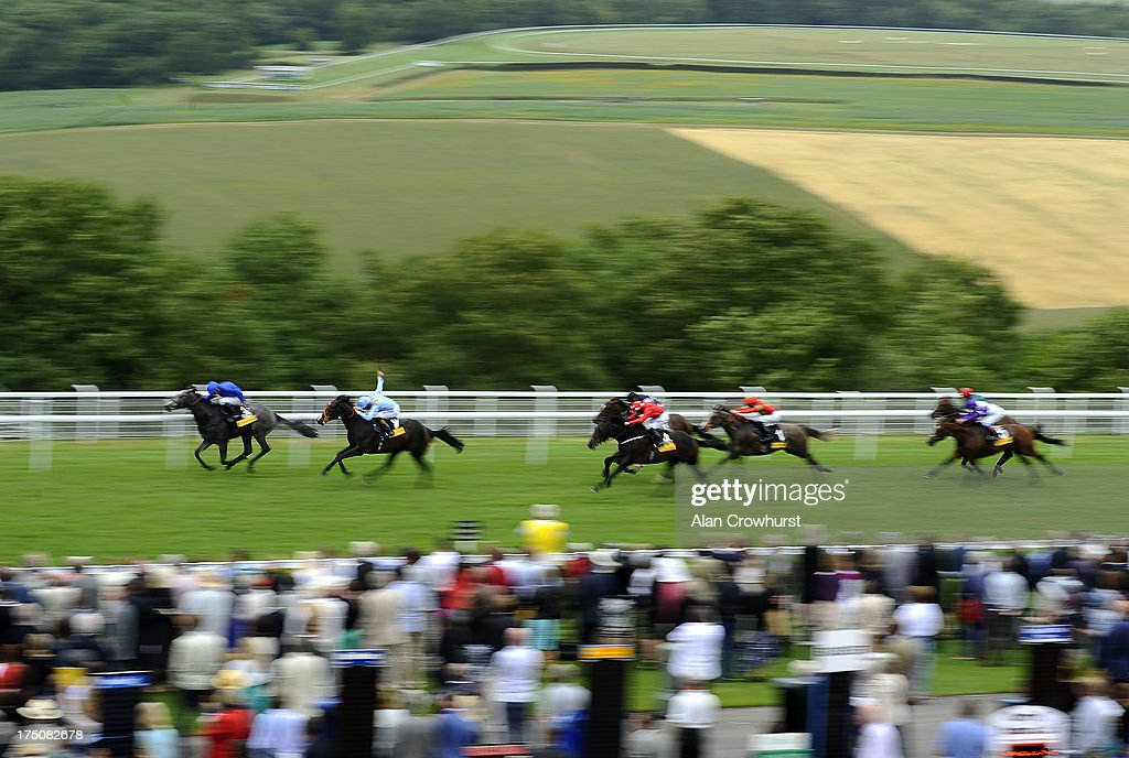<a gi-track='captionPersonalityLinkClicked' href=/galleries/search?phrase=Richard+Hughes+-+Jockey&family=editorial&specificpeople=206680 ng-click='$event.stopPropagation()'>Richard Hughes</a> riding Toormore (2nd L) on their way to winning The Veuve Clicquot Vintage Stakes at Goodwood racecourse on July 31, 2013 in Chichester, England.