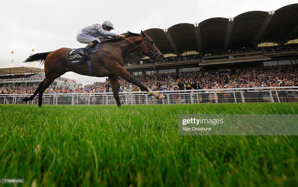 <a gi-track='captionPersonalityLinkClicked' href=/galleries/search?phrase=Richard+Hughes+-+Jockey&family=editorial&specificpeople=206680 ng-click='$event.stopPropagation()'>Richard Hughes</a> riding Toronado win The Qipco Sussex Stakes at Goodwood racecourse on July 31, 2013 in Chichester, England.