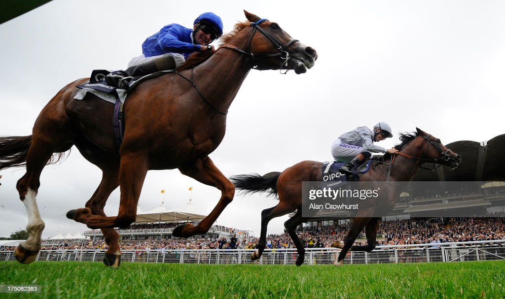 <a gi-track='captionPersonalityLinkClicked' href=/galleries/search?phrase=Richard+Hughes+-+Jockey&family=editorial&specificpeople=206680 ng-click='$event.stopPropagation()'>Richard Hughes</a> riding Toronado (R) win The Qipco Sussex Stakes from Dawn Approach at Goodwood racecourse on July 31, 2013 in Chichester, England.