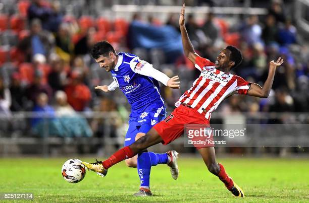 Richard Hurlin of the Power and Bruce Kamau of Melbourne City challenge for the ball during the FFA Cup round of 32 match between the Peninsula Power...