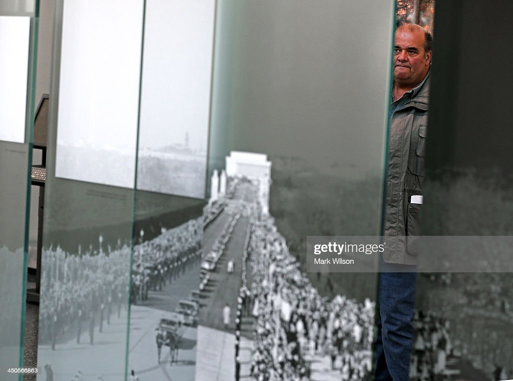 Richard Ingram of Vancouver, Canada looks at an exhibit showing the funeral of the nations 35th President John F. Kennedy at Arlington Cemetery on November 19, 2013 in Arlington, Virginia. The 50th anniversary of President Kennedy's assassination is Friday November 22, 2013.