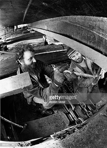 Richard Jaksland left and Fred Paulsen both of Gloucester Mass install new planking on the 60foot keel of the Mayflower II while the replica ship is...