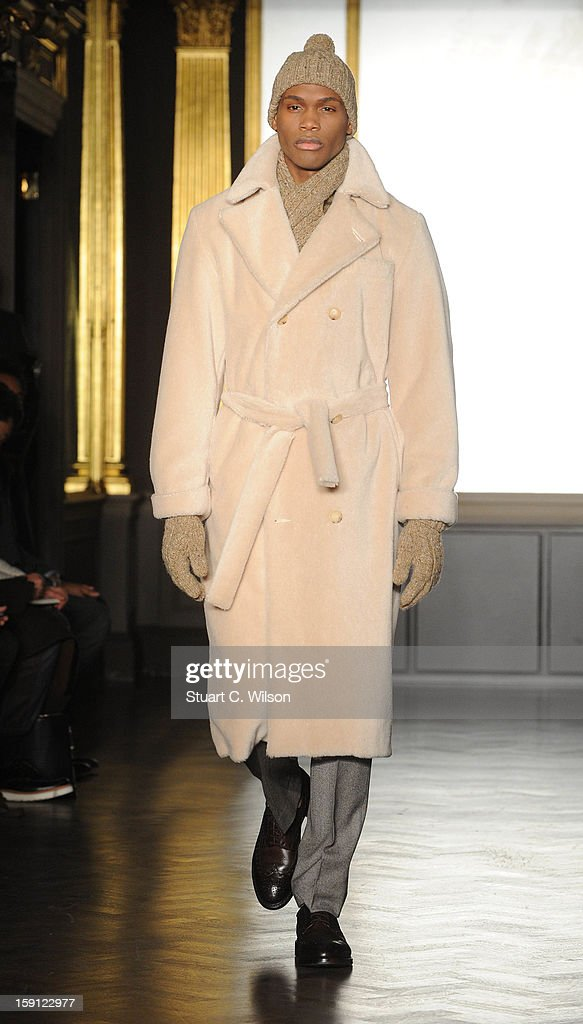 Richard James appears on the catwalk after his show at the London Collections: MEN AW13 at Cafe Royal on January 8, 2013 in London, England.