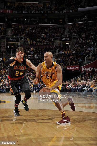 Richard Jefferson of the Cleveland Cavaliers drives to the basket against Kyle Korver of the Atlanta Hawks on April 11 2016 at Quicken Loans Arena in...