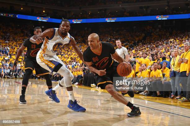 Richard Jefferson of the Cleveland Cavaliers drives to the basket around Kevin Durant of the Golden State Warriors in Game Five of the 2017 NBA...