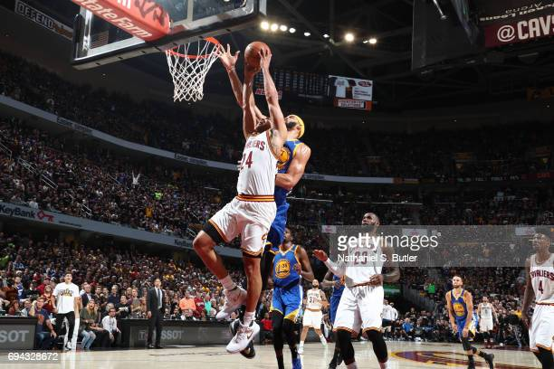 Richard Jefferson of the Cleveland Cavaliers goes up for a dunk around JaVale McGee of the Golden State Warriors in Game Four of the 2017 NBA Finals...