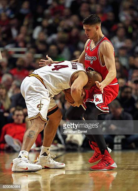 Richard Jefferson of the Cleveland Cavaliers tries to move against Doug McDermott of the Chicago Bulls at the United Center on April 9 2016 in...
