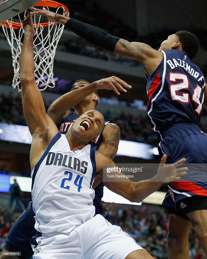 Richard Jefferson #24 of the Dallas Mavericks draws the foul from Thabo Sefolosha #25 of the Atlanta Hawks in the second half at American Airlines Center on December 22, 2014 in Dallas, Texas.