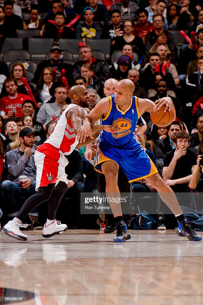 Richard Jefferson #44 of the Golden State Warriors posts-up against John Lucas #5 of the Toronto Raptors on January 28, 2013 at the Air Canada Centre in Toronto, Ontario, Canada.