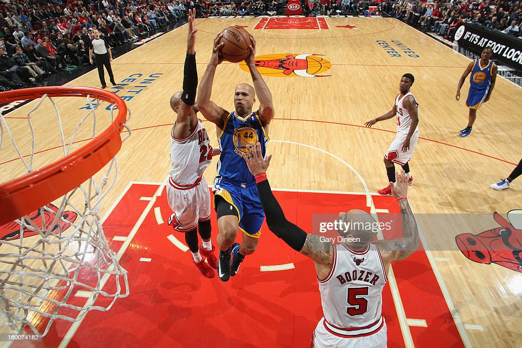 Richard Jefferson #44 of the Golden State Warriors shoots against (L-R) Taj Gibson #22 and Carlos Boozer #5 of the Chicago Bulls on January 25, 2012 at the United Center in Chicago, Illinois.