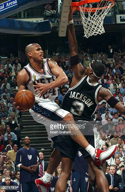 Richard Jefferson of the New Jersey Nets drives to the basket against Stephen Jackson of the San Antonio Spurs during game four of the 2003 NBA...